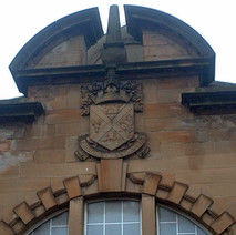 The old Clydebank coat of arms on the old Bruce Street swimming baths.  -  27th January 2002