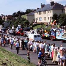 Lots of spectators watching the procession in Parkhall. Clydebank Centenary Celebrations 1986 - photo by Sam Gibson