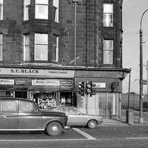 Kizil Mansions.  The shop on the corner used to be John Temple the tailors. I used to buy clothes from there. - Saturday 3rd March 1979 Glasgow Road