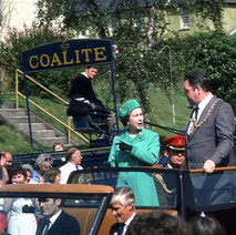 The Queen being driven through Parkhall in the open-top car with the Provost of Clydebank. Clydebank Centenary Celebrations 1986 - photo by Sam Gibson