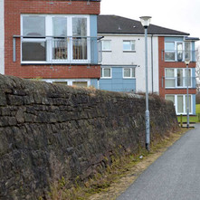 Very old wall beside modern flats on the Forth & Clyde Canal. Clydebank - 26th January 2013