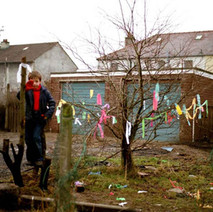 Young Stephen playing at the end of Low Crescent. This is where Harvey's wee shop used to be. Nice Christmas tree. - Whitecrook, Clydebank. December 1981