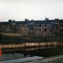 The Forth & Clyde Canal with the Kilbowie Road tenements in the background. - Photo by Tommy Quinn.