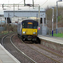 Electric train pulling into Yoker Station.  -  23rd January 2020