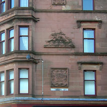 Detail of the stone carvings on the tenement building. 7th February 2009 Dumbarton Road, Dalmuir