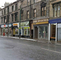 A row of tenement shops on Kilbowie Road. - December 1981