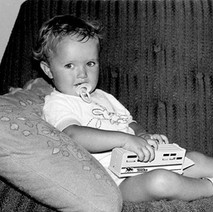 My son Michael. He grew out of the dummy eventually but still likes his toys... motor bikes and cars.  - Low Crescent 1982