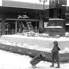 Little girl with a big trolley passing the water sculpture. - 2nd February 1980
