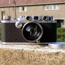 Old Leica camera from around 1941. I only had a loan of it for a day, so I never actually got to use it. Low Crescent, Whitecrook, Clydebank. 29th May 1978