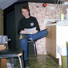 David deciding what negative to print. The sink and the green lino came from my sister's house in Maryhill before the tenement was demolished. - Low Crescent 2nd September 1982