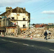 Connolly's Pub on Glasgow Road being demolished to make way for the Clydeside Expressway. The big co-op can be seen in the background. - March 1980