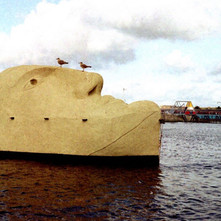 I checked my photos I took at the Glasgow Garden Festival in 1988 and there it was. The 'Stone' Head. It was a floating sculpture at the Festival. - The Glasgow Garden festival 1988