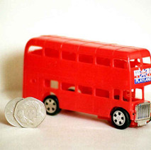 Michael got this red bus from the Co-op Santa, cost 60 pence. Now he drives buses! - December 1981