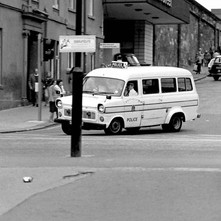 A police van answering a call. I was sitting on George Square when I heard the siren, turned round and took the photo quickly, hence the pole spoiling the shot. - 2nd July 1979