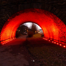 The underpass is all lit up red now. Goods trains used to run through here straight into John Brown's Shipyard. We had several goods yards in Clydebank at one time. - 29th January 2011