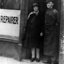 Patricia Ward's grandparents outside their shoe repair shop on Dumbarton Road near the Town Hall. - Photo supplied by Jimmy and Patricia Ward.