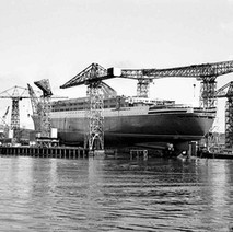 The QE2 on the stocks, surrounded by the cranes almost ready to be launched. - John Brown Shipyard, Clydebank, 1967. Photo by William Duncan