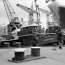 Tug boat and cranes. John Brown Shipyard, Clydebank, 1967. Photo by William Duncan
