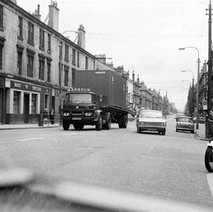 Looking down Dumbarton Road, Bruce Street on the right. - Photo by William Duncan