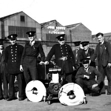 Photograph of John Brown's firemen sent to me by Frances McGonigal (nee McGarvey). Father Bob McGarvey is second from the left. My dad was a fireman with John Brown's too.