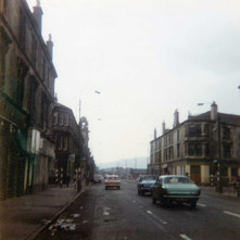 Glasgow Road/Dumbarton Road at the bottom of Kilbowie Road.  -  1979 Photograph by Stephen Stenson