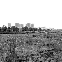 This looks like Singer waste ground at the Dalmuir end, now the site of the Clydebank Business Park.  -  Photo by William Duncan
