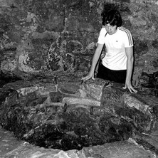 Paul looking at the Bottle Dungeon in St Andrews Castle, one of the most infamous castle prisons in medieval Britain, cut out of solid rock. - 16th July 1978