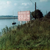 Sign on the Clyde warning ships to slow down passing Brown's basin. - Photo by Tommy Quinn. October 1978