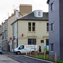 lokking down Dunedin Terrace from the new build on the site of old St Andrew's School. The Douglas Hotel on the corner of North Douglas Street.  -  1st February 2021
