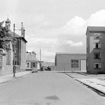 Looking down North Bank Street, in the background on the left, the Clydebank Bowling Club, and on the right, the UCBS biscuit factory. - Photo by William Duncan