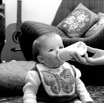 Jennifer enjoying her bottle. - Whitecrook January 1979