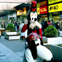 Pluto and Snoopy. Charity Workers dressed up raising money for Spina Bifida. - 3rd December 1982