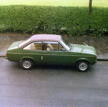 Our Ford Escort sitting in Dunedin Terrace. Check it out, wing mirrors, no headrests, no airbags and it's got fabric stuck on the roof. - Dunedin Terrace 13th August 1977