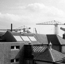 Looking out the back window of the Town Hall, over the rooftops of the Bruce Street Baths towards the shipyard cranes. - Photo by William Duncan