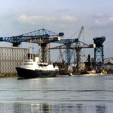 The Royal Yacht Britannia passing the former John Brown's Shipyard. Clydebank Centenary Celebrations 1986 - photo by Wallace McIntyre