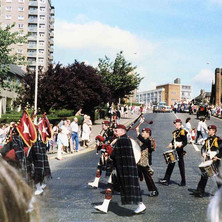 Pipe Band on Kilbowie Road turning into Second Avenue.  -  Clydebank Centenary Celebrations 1986  -  Photo by Wallace McIntyre