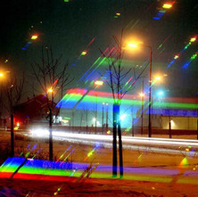 Argyle Road in the snow, a time exposure taken through a diffraction filter. - Argyle Road, Clydebank. January 1981