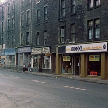 Shops and the old tenements on Glasgow Road. - Photo by Tommy Quinn.