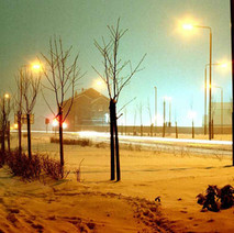 Argyle Road looking towards the shipyard during a snow storm. I am in the tunnel under the railway to protect myself and my camera.  -  January 1981