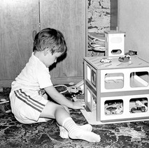 Craig playing with Jen's garage. I made one for Michael too.  -  Low Cresent 1982