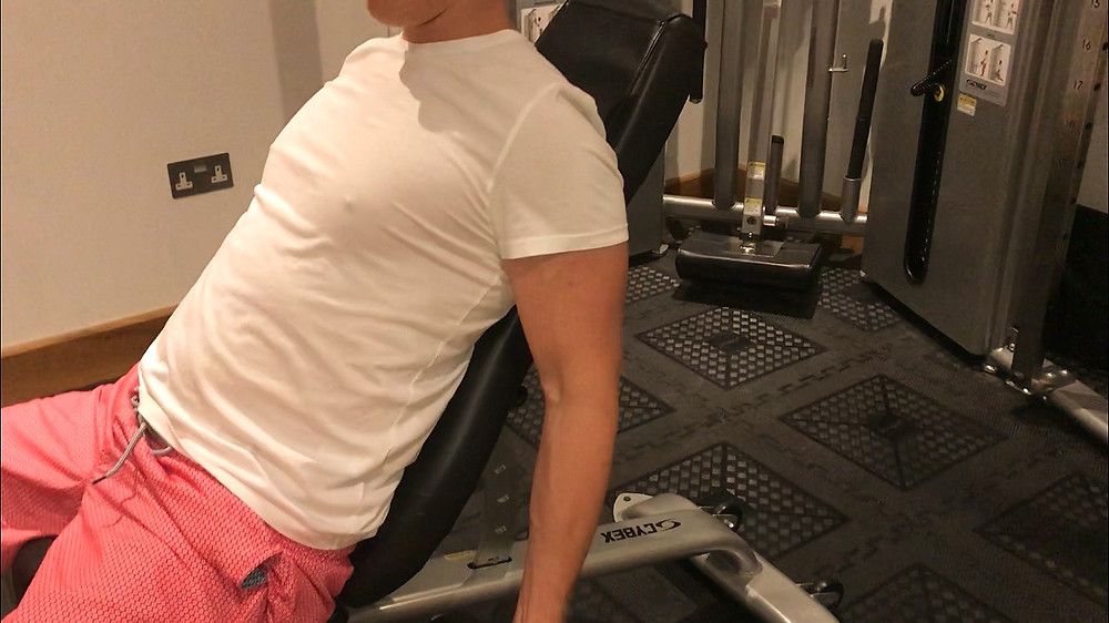 Seated Incline Bench Bicep Stretch