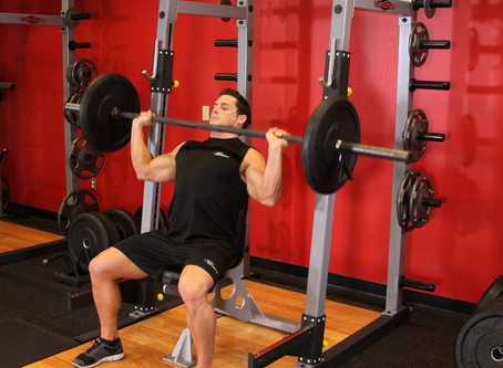 How To Do The Seated Barbell Shoulder Press [Exercise Guide]