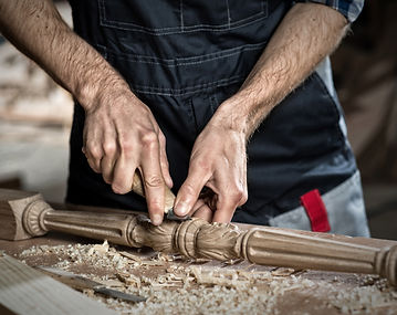 Close up carpenter's hands that work wit