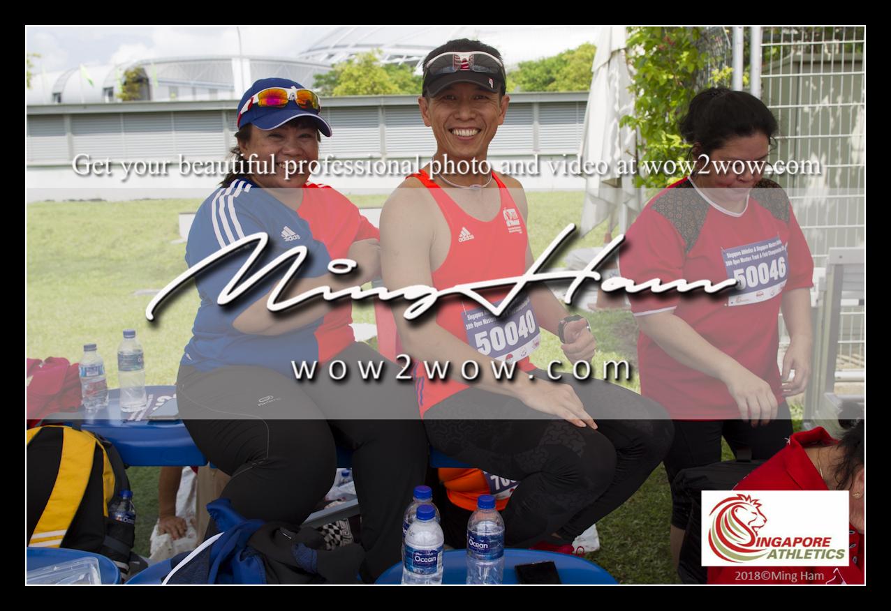 2018_Singapore Masters_0825 [Men M50 100m 50040 Esmond Choo and wife]