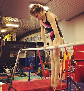 Developmental gymnastics uneven bars front supprt