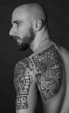 polonesian shoulder an back tattoo