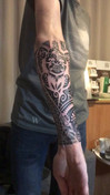 polonesian tribal tattoo onderarm