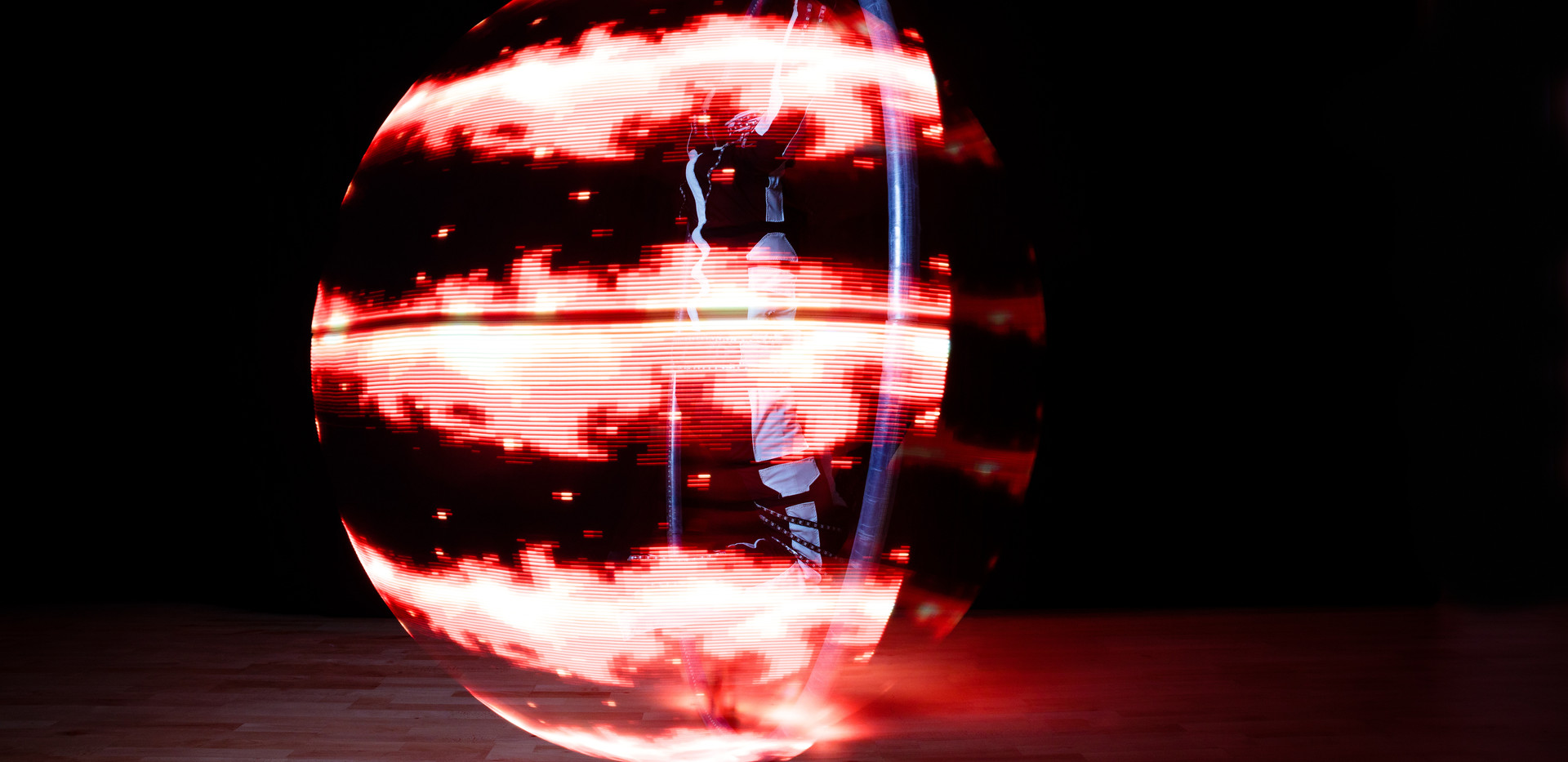 Glow Cyr Wheel Show for Hire London UK