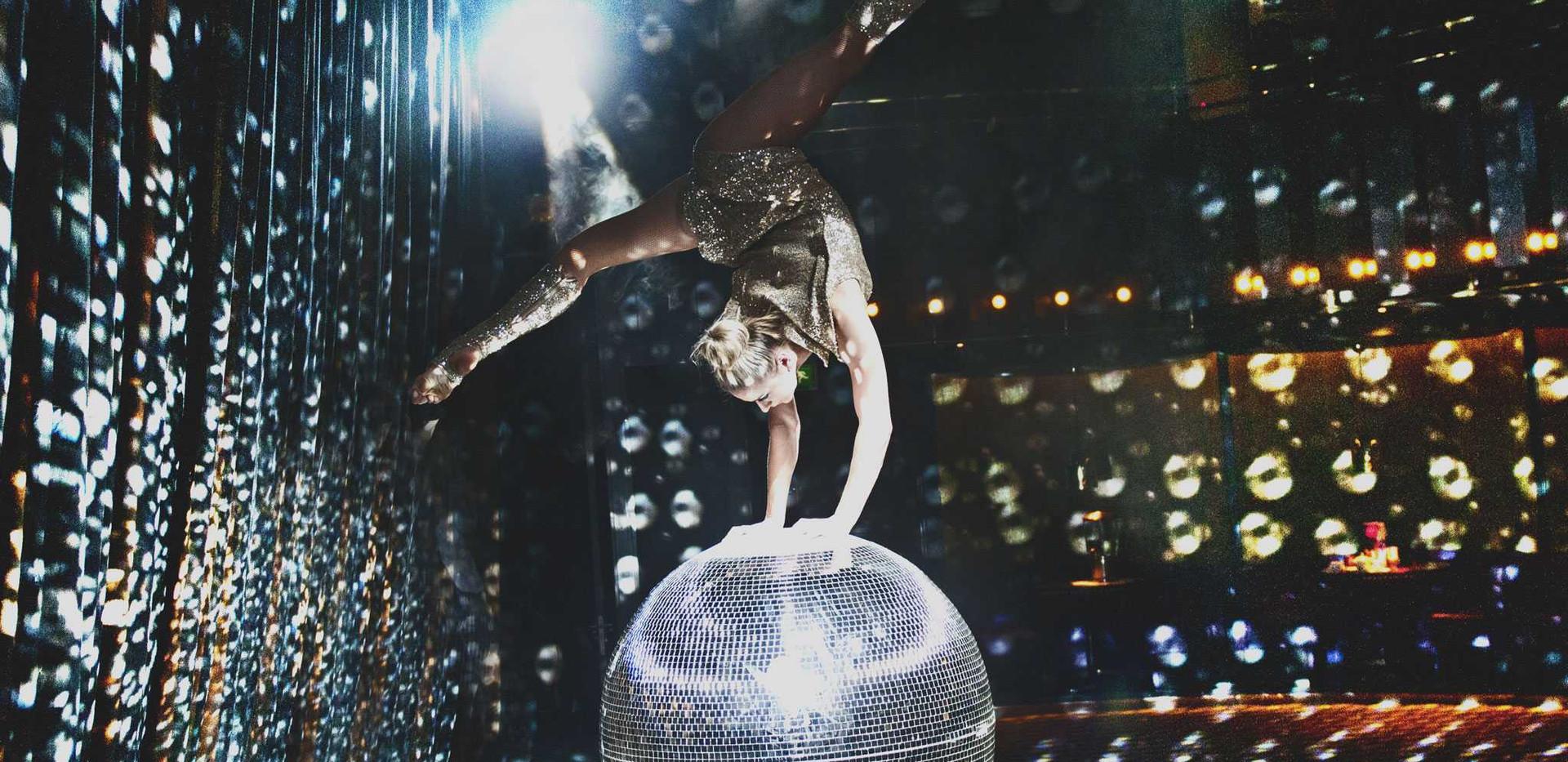 Book glitterball acrobat act London