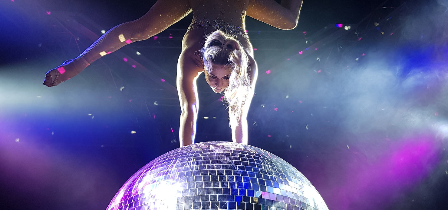 Hire beautiful mirrorball acrobat act for your event or party UK wide disco ball glitterball contortionist showgirl dancer acrobat hire